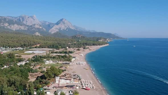 Thumbnail for Aerial drone shot of the ocean, beach and mountain coast in Antalya, Kemer, Turkey