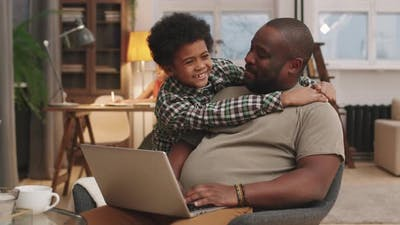 Portrait Of Afro Son And Dad Hugging
