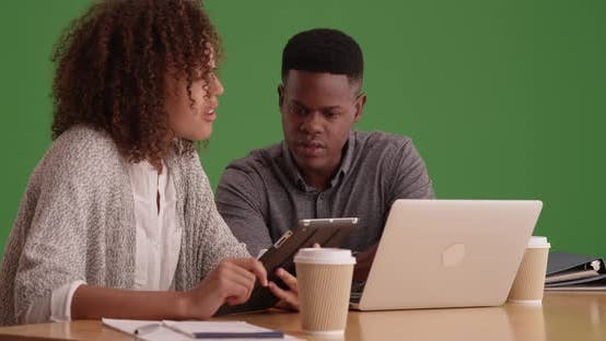 Cover Image for Young black millennials working at a home business on green screen