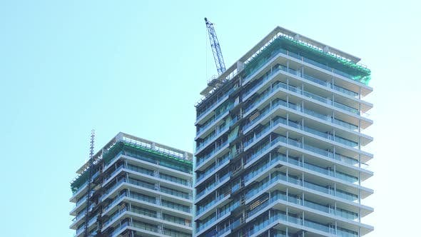 Thumbnail for Tops of Two High-rise Buildings Under Construction - the Clear Blue Sky in the Background