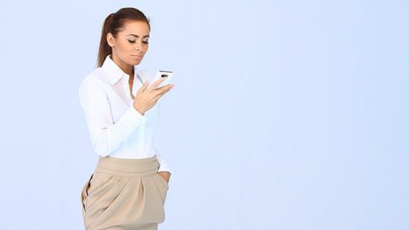 Elegant Business Woman Using Mobile Phone