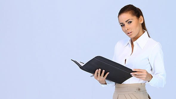 Thumbnail for Beautiful Business Woman Checking Her Notes