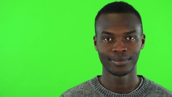 Thumbnail for A Young Black Man Smiles at the Camera - Face Closeup - Green Screen Studio