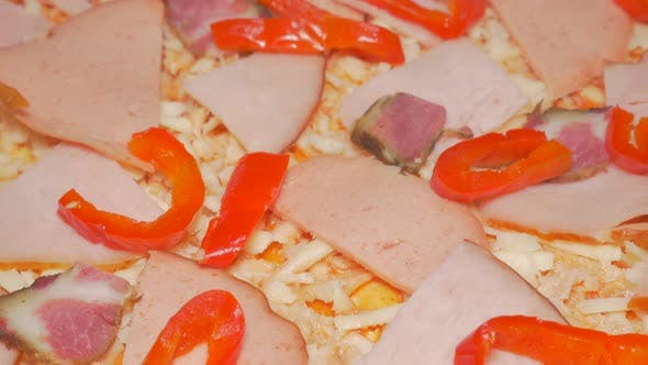 Thumbnail for Pizza making phase with adding paprika slices  slices 4K 2160p UHD slow tilting  video - Pizza prepa