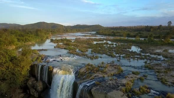 Cover Image for Water Falls Down From Stone River Plate at Sunset