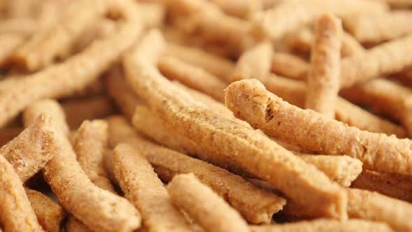 Thumbnail for Slow tilt on crisp integral breadsticks snack with chilli 4K 2160p 30fps UltraHD footage - Tasty dee