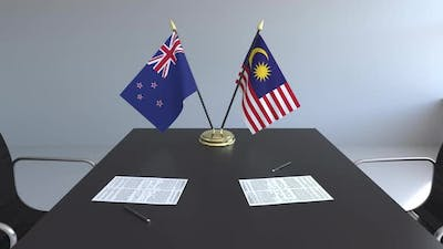 Flags of New Zealand and Malaysia and Papers