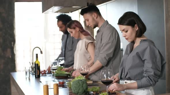 Thumbnail for Beautiful Woman Cooking with Friends and Posing for Camera