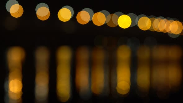 Thumbnail for Abstract Lights and Their Reflections in the Water Bokeh Background