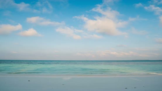 Thumbnail for Time lapse: morning time on white sand beach tropical sea colorful dramatic sky