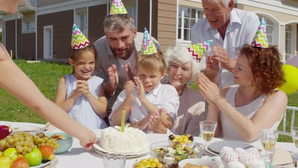 Thumbnail for Little Boy Clapping Hands and Enjoying Birthday Cake on Family Party