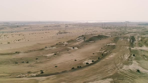 Thumbnail for Aerial view of man practicing motocross at desert landscape, U.A.E.