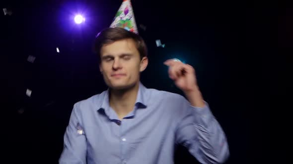 Thumbnail for Guy Throwing Glitter Confetti, Blowing Party Whistle and Dance. Close-up