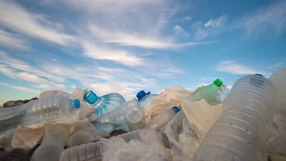 Thumbnail for Timelapse. Plastic Bottles in a Polluted. Clouds Background