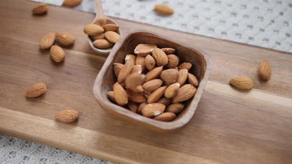 Thumbnail for Healthy Food Concept. Almond Nuts In Wooden Bowl. Closeup.