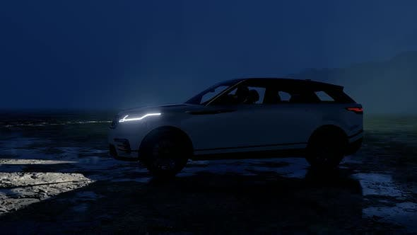 SUV Driving on the Wet Road at Night