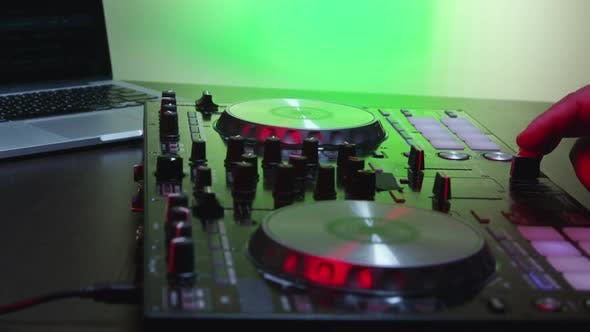 Cover Image for Male DJ Hands Turning Controls And Mixing 20