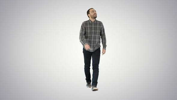 Thumbnail for Young man walking looking up fascinated on gradient background