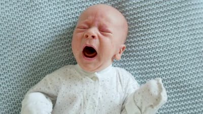 portrait of a crying screaming baby