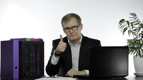 Thumbnail for Happy Businessman Manager Giving Thumbs Up Sitting at Office Table