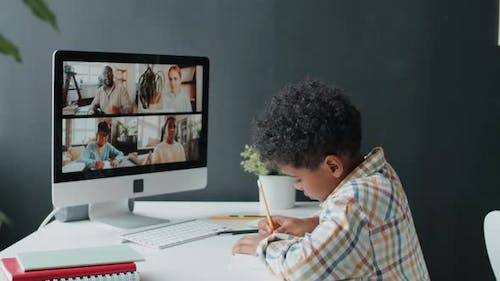 Afro-American Boy Taking Online Class at Home