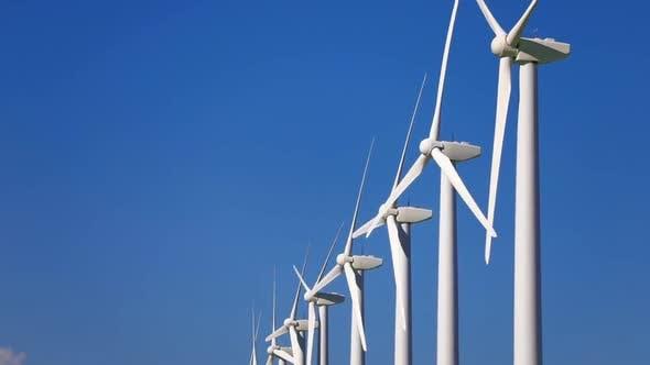 Thumbnail for Wind Turbines and Energy Farm at Dusk. Alternative Renewable Energy Production.