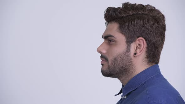 Thumbnail for Closeup Profile View of Young Bearded Indian Businessman