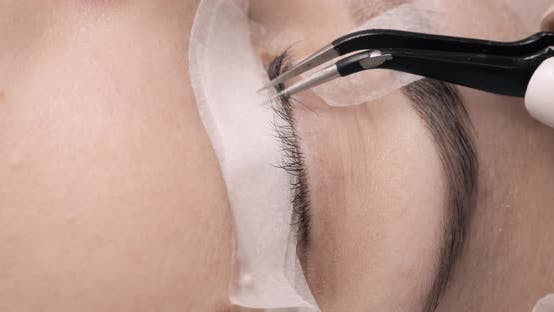 Thumbnail for Professional Eyelash Extension Procedure in Close Up