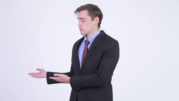 Thumbnail for Young Handsome Businessman Presenting Something