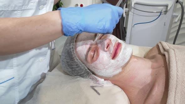 Thumbnail for Happy Man Getting Facial Masks at Beauty Salon, Smiling with His Eyes Closed
