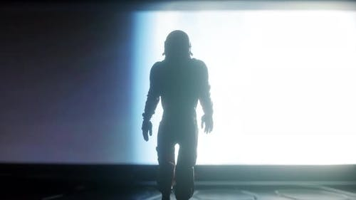 Following Shot of Astronaut in Space Suit Confidently Walking on Spaceship