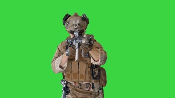 Soldier Shoots Aming and Shooting with Rifle on a Green Screen, Chroma Key