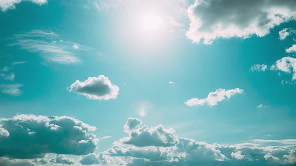 Cloudy Sky With Fluffy Clouds
