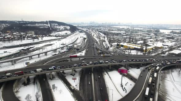 Thumbnail for Car Traffic on Highway Junction in Winter City. Aerial View Winter Crossroad