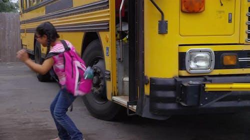 Students get off school bus