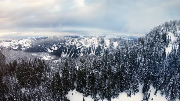 Cover Image for Pacific Northwest Snow Covered Mountain Range Winter Aerial Background