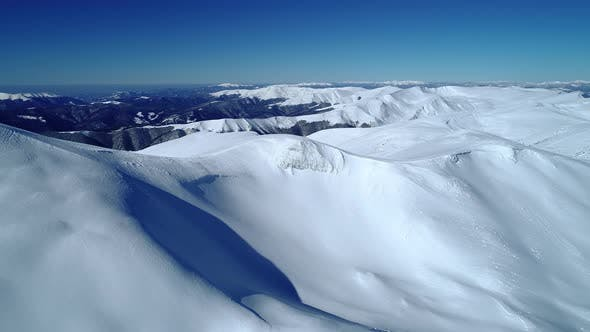 Thumbnail for Flight Over the Turquoise Snowy Mountains Illuminated By the Day Sun