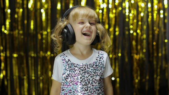 Thumbnail for Child Dances, Sings, Listens Music on Headphones. Little Kid Girl Having Hun, Relaxing and Enjoying
