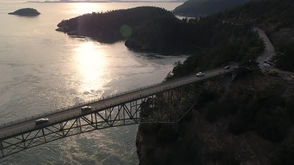 Thumbnail for Pacific Northwest Aerial Of Cars Crossing Ocean Bridge To Puget Sound Island With Golden Hour