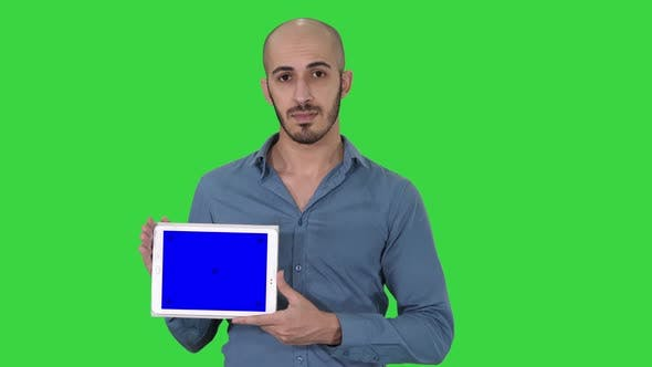 Thumbnail for Arab Man Showing Blank Tablet Screen on a Green Screen, Chroma Key