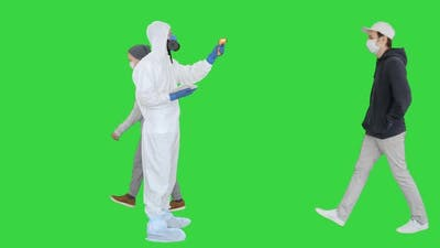 Man in Hazmat Suit Checking Temperature and Stopping Woman on a Green Screen, Chroma Key.