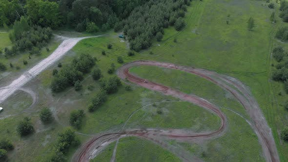 Thumbnail for Professional motocross bike rider drives on motocross motorcycle track