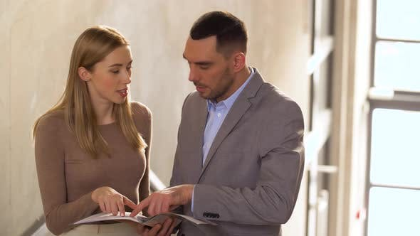 Thumbnail for Businesswoman and Businessman Discussing Folder 57