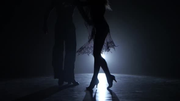 Dance Couple Demonstrating Magnificent Choreography of Salsa, Black Background