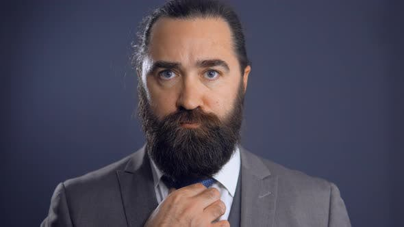 Thumbnail for Confident Middle-Aged Bearded Man Wearing Business Suit