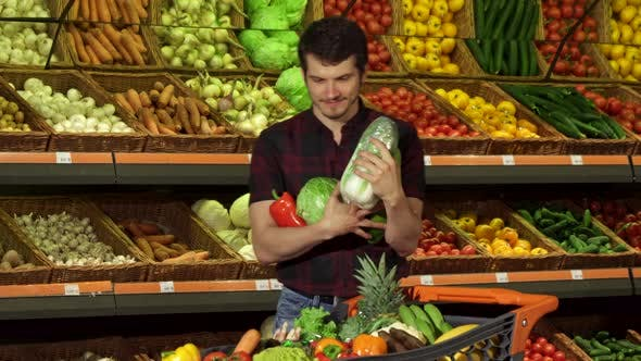 Thumbnail for Man Puts Different Vegetables Into the Shopping Cart