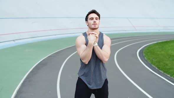 Thumbnail for Runner Warming Up at Modern Stadium. Sport Man Stretching at Stadium