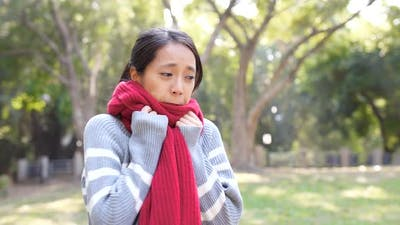 Woman feeling cold in the winter time