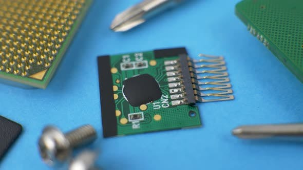 Thumbnail for Electronic Green Circuit Board with Microchip and Transistors