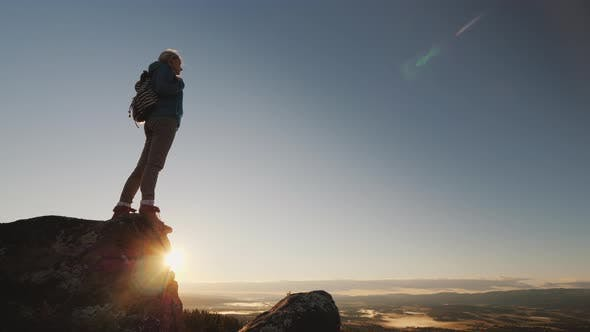 Thumbnail for Active Woman Rises To the Top of the Mountain, Admires the Beautiful Scenery of Norway